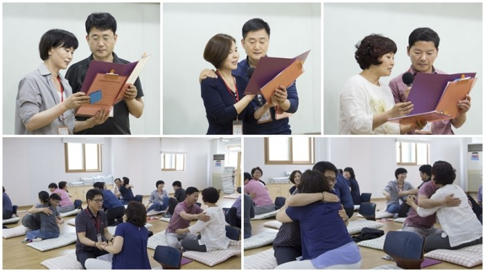 부부 교육 명상 프로그램 참가 후 안아주고 있다